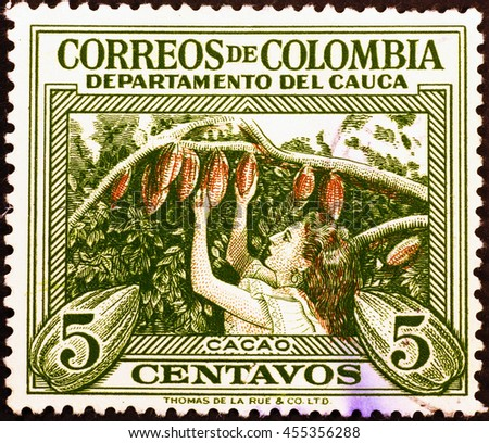 Milan, Italy - July 30, 2015: Cocoa picking in colombian postage stamp - stock photo
