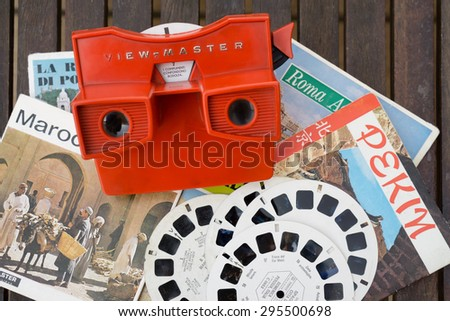 MILAN, ITALY - JULY 5, 2015: view-master vintage 3d viewer toy has introduced to the wonder of 3D generations of kids for over 75 years - stock photo