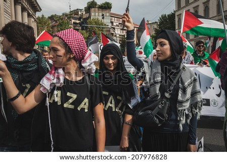 MILAN, ITALY - JULY 26: Young muslim women march and protest against Gaza strip bombing in solidarity with Palestinians on JULY 26, 2014 in Milan. - stock photo