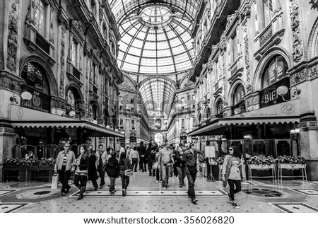 MILAN, ITALY - 4 JUN 2014: Unique view inside Galleria Vittorio Emanuele II. Built in 1875 this gallery is one of the most popular shopping areas in Milan. - stock photo