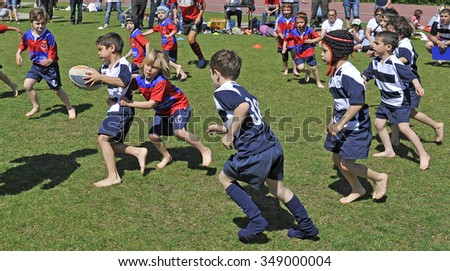 MILAN, ITALY-JUNE 02, 2013: children playing rugby during a sunday morning campus at the Arena stadium, in Milan.