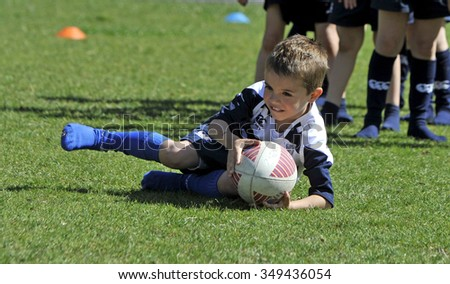MILAN, ITALY-JUNE 02, 2013: children practicing during a rugby school session in the park, in Milan.