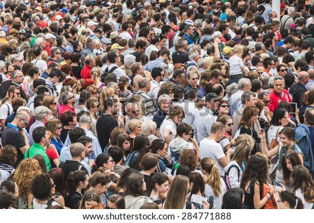 MILAN, ITALY - JUNE 1: Crowd outside the main gate at Expo, universal exposition on the theme of food on JUNE 1, 2015 in Milan.