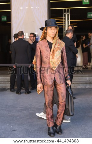 MILAN, ITALY - JUNE 20: Fashionable man poses outside Etro fashion show building during Milan Men's Fashion Week on JUNE 20, 2016 in Milan.