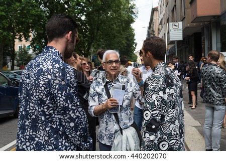 MILAN, ITALY - JUNE 18: Fashionable people gather outside Marni fashion show building for Milan Men's Fashion Week on JUNE 18, 2016 in Milan.