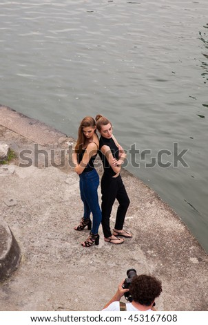 MILAN, ITALY - JUNE, 12: Models during a photoshoot on June 12, 2016 - stock photo