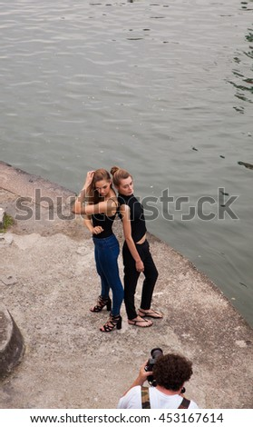 MILAN, ITALY - JUNE, 12: Models during a photoshooting on June 12, 2016 - stock photo