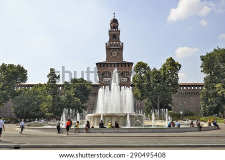 MILAN, ITALY- JUNE 11, 2015: People appreciate the fountain in front of  the Castello Sforzesco which is the oldest and largest castle in town and a major tourists destination - stock photo