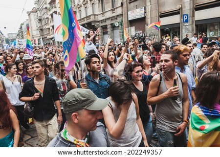 MILAN, ITALY - JUNE 28: People at gay pride parade in Milan JUNE 28, 2014. Thousands of people march in the city streets for the annual gay pride parade, claiming equality and legal rights.