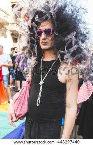 MILAN, ITALY - JUNE 25: People at Pride parade in Milan JUNE 25, 2016. Thousands of people march in the city streets for the annual Pride parade, claiming equality and legal rights. - stock photo