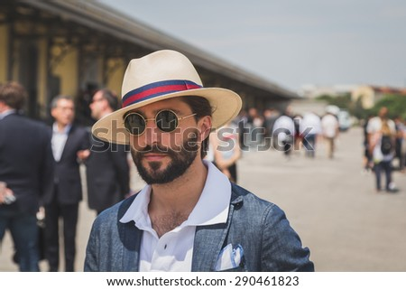 MILAN, ITALY - JUNE 22: People gather outside Gucci fashion show building for Milan Men's Fashion Week on JUNE 22, 2015 in Milan.