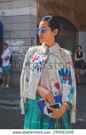MILAN, ITALY - JUNE 21: People gather outside Missoni fashion show building for Milan Men's Fashion Week on JUNE 21, 2015 in Milan.