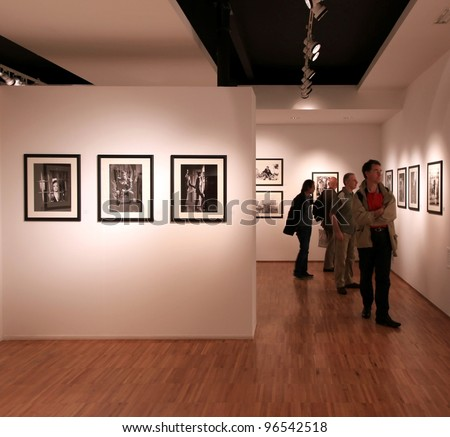 MILAN, ITALY - JUNE 16: People look at Phil Stern photos exhibition opening at Forma Photography Foundation June 16, 2010 in Milan, Italy. - stock photo