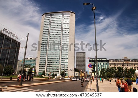 MILAN, ITALY - JUNE 27, 2016: people under the Pirellone building, grattacielo Pirelli, in Piazza Duca D Aosta, former seat of  Lombardy regional government
