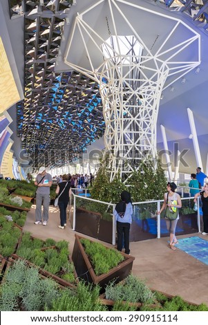 MILAN, ITALY - JUNE 6 2015: People visit Iran pavilion at Expo 2015, universal exposition on the theme of food - feed the planet  - stock photo
