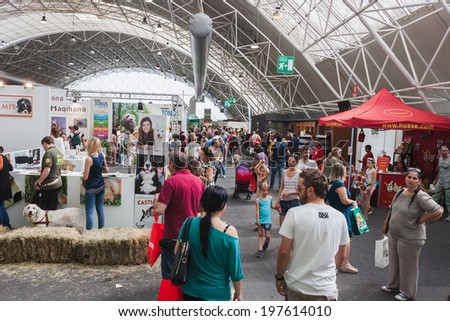 MILAN, ITALY - JUNE 7: People visit Quattrozampeinfiera, event and activities dedicated to dogs, cats and their owner on JUNE 7, 2014 in Milan.
