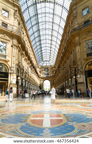 Milan, Italy - June 11, 2010: People walk by the Gallery Emanuele Vittorio, famous shopping mall of Europe