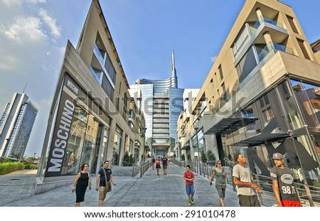 MILAN, ITALY- JUNE 11, 2015: Some people walking in the commercial area of the piazza Aulenti and the Unicredit Tower, Milano skyline palazzo Unicredit - stock photo