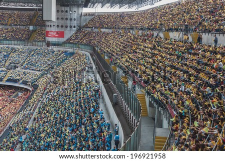MILAN, ITALY - JUNE 2: 50.000 teenagers take part in a ceremony at San Siro stadium where archbishop Scola meets them before they receive the sacrament of Confirmation on JUNE 2, 2014 in Milan.