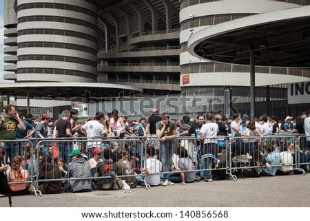 MILAN, ITALY - JUNE 3: Thousands of fans at Springsteen world tour in Milan JUNE 3, 2013. Thousands of fans gather outside the stadium waiting for the gates to open at Bruce Springsteen world tour. - stock photo