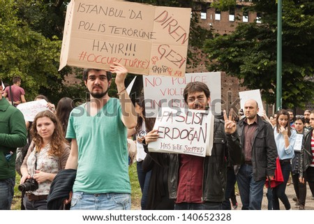 MILAN, ITALY - JUNE 1: Turkish people during a protest march in Milan JUNE 1, 2013. Turkish people protest against prime minister Erdogan for the violent attacks by riot police at Gezi Park (Istanbul)