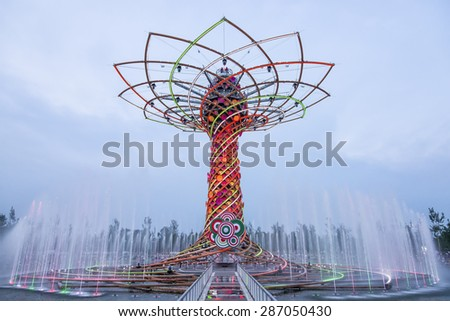 MILAN, ITALY - JUNE 6 2015: View of The tree of life during water-play show. The tree of life is the symbol of Expo 2015 universal exposition on the theme of food - feed the planet. - stock photo