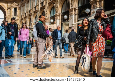 MILAN, ITALY - MAR 29, 2014: Galleria Vittorio Emanuele II, one of the world's oldest shopping malls. The gallery is built between 1865 and 1877 by Giuseppe Mengoni - stock photo