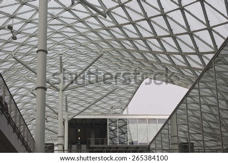 MILAN, ITALY - MARCH 20 2015: Architectural detail of Milano Fiera roofing project in glass and steel by Architect Massimiliano Fuksas - stock photo