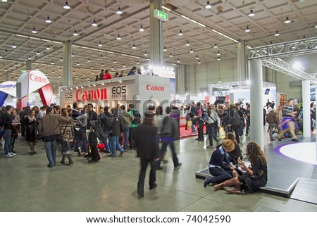 "MILAN, ITALY - MARCH 27: Canon stand at international photographic Fair ""Photoshow"" in Milan (25-28 March 2011), March 27, 2011 - stock photo"