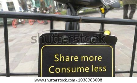 "Milan, Italy - March 2018: Chinese Bike Sharing bike Ofo close up detail ""Share More Consume less"" claim"