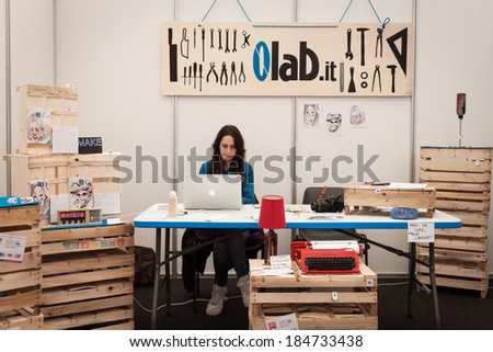 MILAN, ITALY - MARCH 30: Exhibitor in her stand at Robot and Makers Milano Show, event dedicated to robotics and makers on MARCH 30, 2014 in Milan.