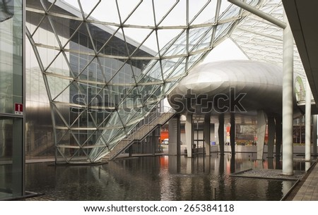 MILAN, ITALY - MARCH 20 2015: Inside the Milan Trade Fair modern building, with its glass and steel architecture - stock photo