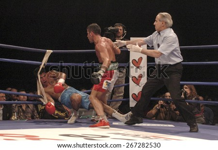 MILAN, ITALY-MARCH 12, 2005: italian boxer Gianluca Branco knock out his rival during a boxing match, in Milan. - stock photo