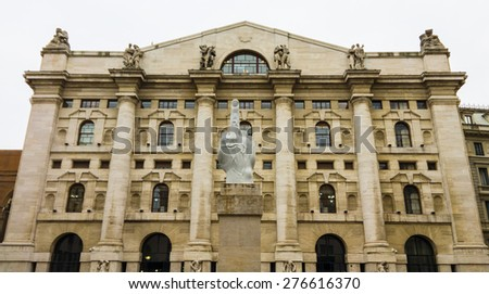 Milan, Italy - March 17, 2015: Italian stock exchange building in Piazza Affari, Milan, featuring the controversial sculpture L.O.V.E. by Maurizio Cattelan. - stock photo
