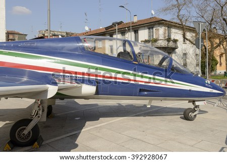 MILAN, ITALY - MARCH 17: jet fighter on temporary display in front of Air Force building in town center as advertisement for aviation exhibition . Shot in bright light on march 17, 2016 Milan, Italy