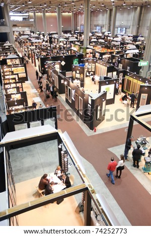 MILAN, ITALY - MARCH 26: Panoramic view of people visiting frames and art stands at Frame Art Expo, Photoshow, International Photo and Digital Imaging Exhibition on March 26, 2011 in Milan, Italy.