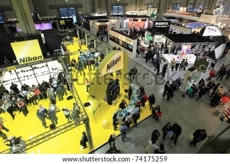 MILAN, ITALY - MARCH 26: Panoramic view of people visiting lenses and cameras stands during PHOTOSHOW, International Photo and Digital Imaging Exhibition on March 26, 2011 in Milan, Italy.