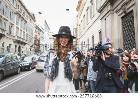MILAN, ITALY - MARCH 1: People gather outside Trussardi fashion show building for Milan Women's Fashion Week on MARCH 1, 2015  in Milan.