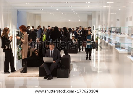 MILAN, ITALY - MARCH 1: People visit Mido, international exhibition for optics, optometry and ophthalmology on MARCH 1, 2014 in Milan.