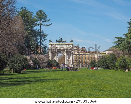 MILAN, ITALY - MARCH 28, 2015: People visiting the Parco Sempione large central park - stock photo