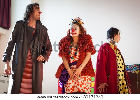 MILAN, ITALY - MARCH 5: Performers take part in Milan Clown Festival, international event dedicated to clowns and street theatre on MARCH 5, 2014 in Milan.
