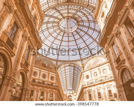 MILAN, ITALY - MARCH 28, 2015: The Galleria Vittorio Emanuele II has been recently restored for the Expo Milano 2015 international exhibition vintage - stock photo