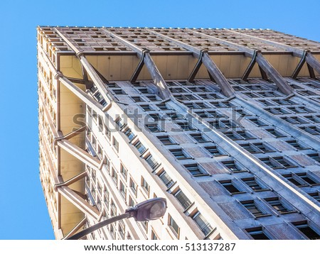 MILAN, ITALY - MARCH 28, 2015: The Torre Velasca designed in 1955 by BBPR is a masterpiece of Italian new brutalist architecture (HDR)