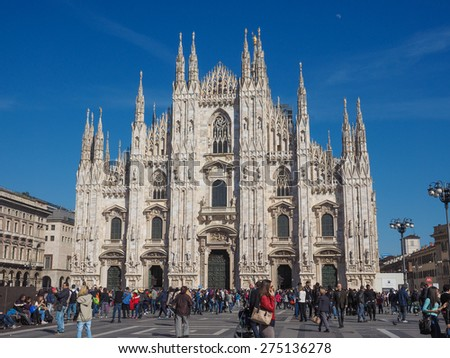 MILAN, ITALY - MARCH 28, 2015: Tourists in the Piazza Duomo square in front of Milan Cathedral church - stock photo