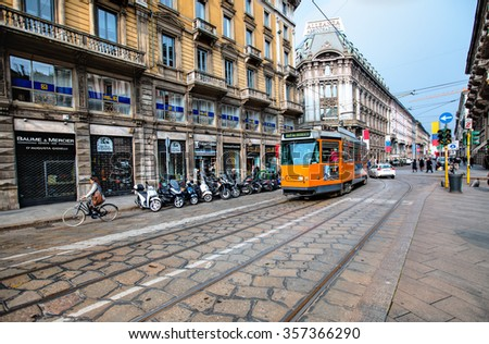 MILAN , ITALY - MARCH 24, 2015: Vintage tram on the city street in Milan