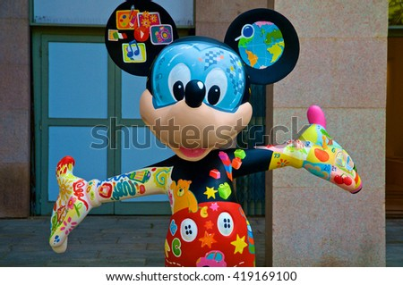 MILAN, ITALY - MAY 7: A figure of Mickey Mouse dressed with many colors and drawings. The statue is part of an artist exposition at the Triennale in May 7, 2016 at Milan, Italy. - stock photo