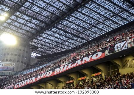 MILAN, ITALY-MAY 04, 2014: AC Milan soccer fans gathering at the San Siro stadium, during the Italian serie A soccer match, AC Milan vs FC internazionale, in Milan. - stock photo