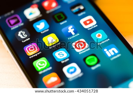 MILAN, ITALY - MAY 27, 2016: Close up of social media app photographed from a smartphone, pleasing defocus due to the inclination. New Instagram icon and snapchat in focus. - stock photo