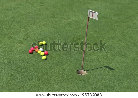 MILAN, ITALY-MAY 28, 2014: colored golf balls on the green, of the San Siro Golf Club, in Milan.