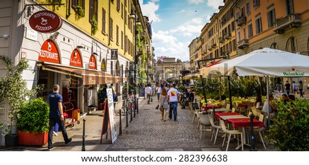 MILAN, ITALY-MAY 24, 2015: Corso Como in Milan is one of the most fashionable streets in the city. Milan is hosting expo 2015.  - stock photo